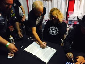 Yoshi signing the book