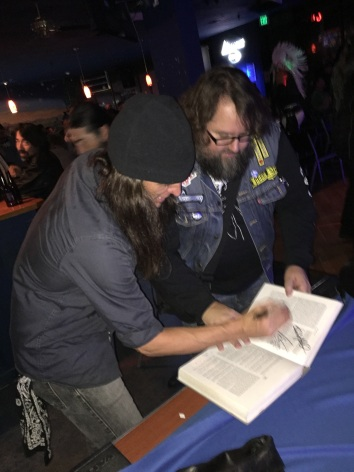 Scott signing the book