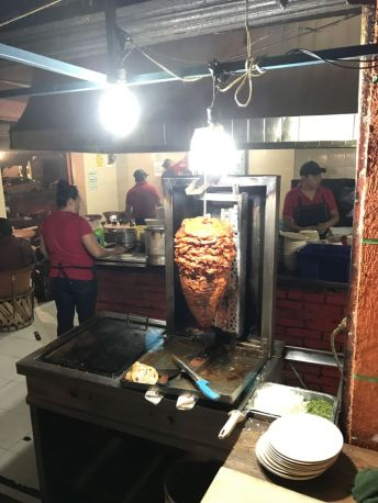 All of the al pastor, please