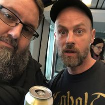 Marco meets me at the airport, hands me a beer.